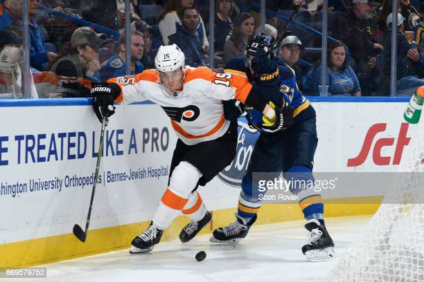 Jori Lehtera of the Philadelphia Flyers and Dmitrij Jaskin of the St Louis Blues battle for the puck at Scottrade Center on November 2 2017 in St...