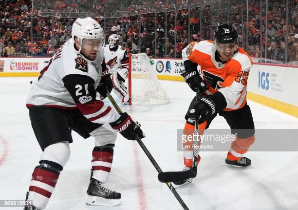 Jori Lehtera of the Philadelphia Flyers battles in the corner against Derek Stepan of the Arizona Coyotes on October 30 2017 at the Wells Fargo...