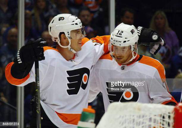 Jori Lehtera of the Philadelphia Flyers celebrates his second period goal against the New York Islanders and is joined by Michael Raffl during a...