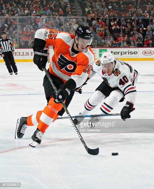 Jori Lehtera of the Philadelphia Flyers controls the puck while being pursued by John Hayden of the Chicago Blackhawks on November 9 2017 at the...