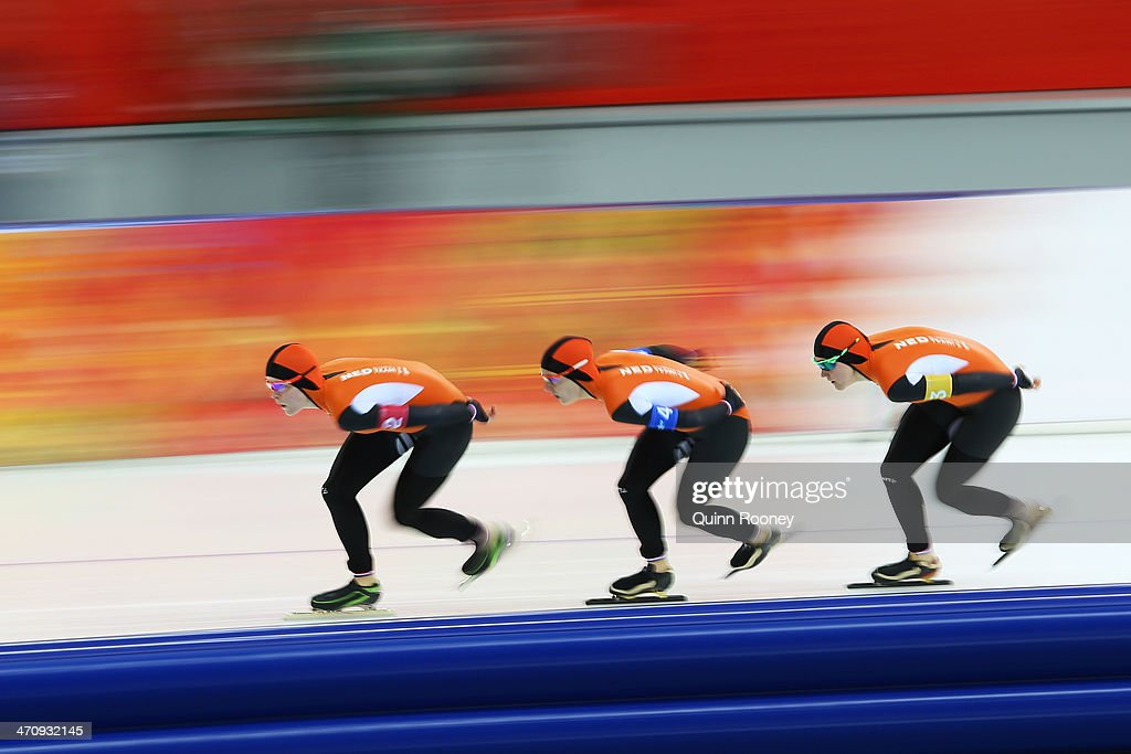 Jorien ter Mors, Ireen Wust and Lotte van Beek of the Netherlands compete during the Women's Team Pursuit Quarterfinals Speed Skating event on day fourteen of the Sochi 2014 Winter Olympics at Adler Arena Skating Center on February 21, 2014 in Sochi, Russia.