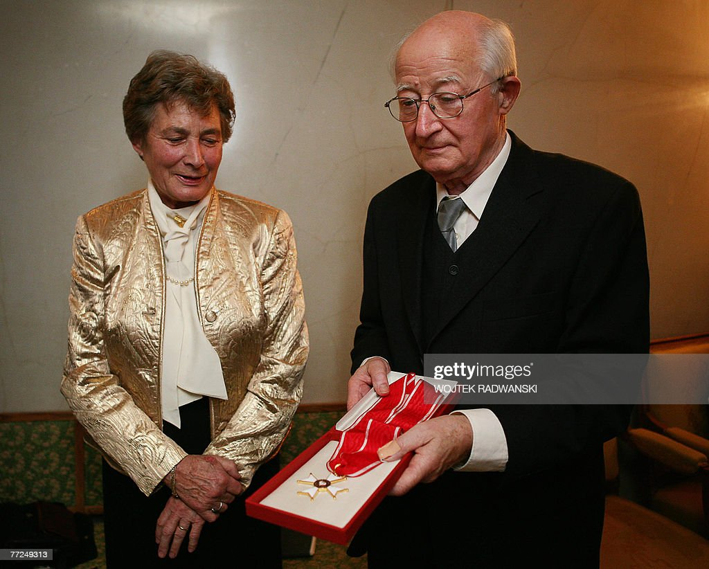 Jorinde Krejci-Hosenfeld (L), daughter of German officer Wilhelm Hosenfeld, and her brother Detlev Hosenfeld show the award they received on behalf of their father 10 October 2007 during an awards ceremony, rewarding 53 people who had risked their lives to save Jews during the Nazi occupation of Poland, at the National Theater in Warsaw. Kaczynski decorated them with the Polonia Restituta award, including Hosenfeld, who saved pianist Wladyslaw Szpilman and whose story was immortalised by Polish-French director Roman Polanski in 'The Pianist.' Woman at center is unidentified.