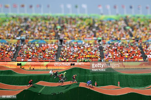 Joris Daudet of France leads the field in the Cycling BMX Men's Quarterfinals on Day 13 of the 2016 Rio Olympic Games at Olympic BMX Centre on August...
