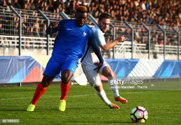 Joris Gnagnon of France and Adam Armstrong of England battle for the ball during the UEFA U20 International Friendly match between France and England...