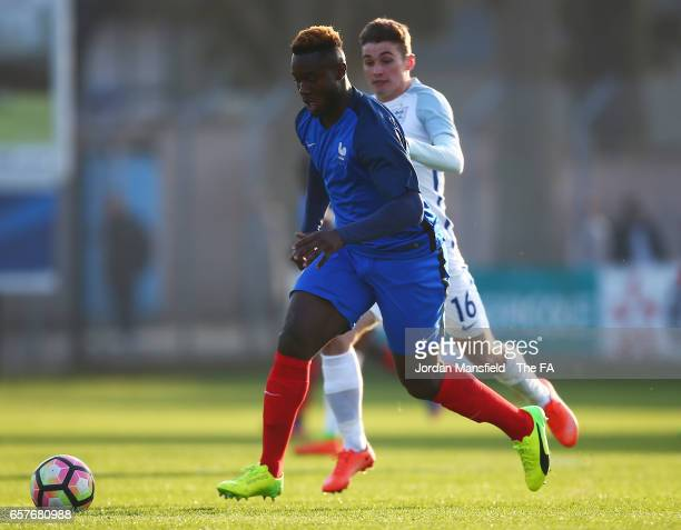 Joris Gnagnon of France is pursued by Ryan Ledson of England during the UEFA U20 International Friendly match between France and England at Stade...