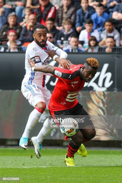 Joris Gnagnon of Rennes and Alexandre Lacazette of Lyon during the French Ligue 1 match between Rennes and Lyon at Roazhon Park on April 2 2017 in...