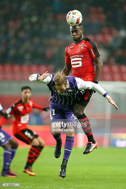 Joris Gnagnon of Rennes and Nils Ola Toivonen of Toulouse during the French Ligue 1 match between Rennes and Toulouse at Roazhon Park on November 25...