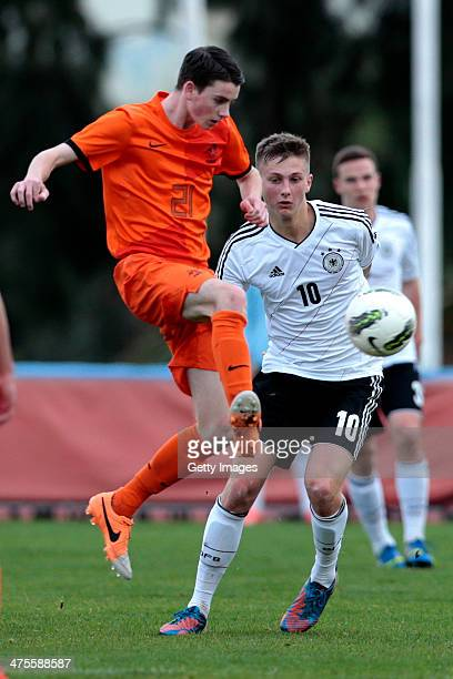 joris klein holte of Netherlands challenges ole kauper of Germany during the Under17 Algarve Cup between U17 Netherlands and U17 Germany at Albufeira...