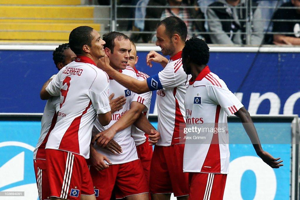 Joris Mathijsen (C) of Hamburg celebrates his team's first goal with team mates during the Bundesliga match between Eintracht Frankfurt and Hamburger SV at the Commerzbank Arena on August 28, 2010 in Frankfurt am Main, Germany.