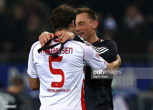 Joris Mathijsen of Hamburg talks to Ivica Olic of Bayern after the Bundesliga match between Hamburger SV and FC Bayern Muenchen at Imtech Arena on...