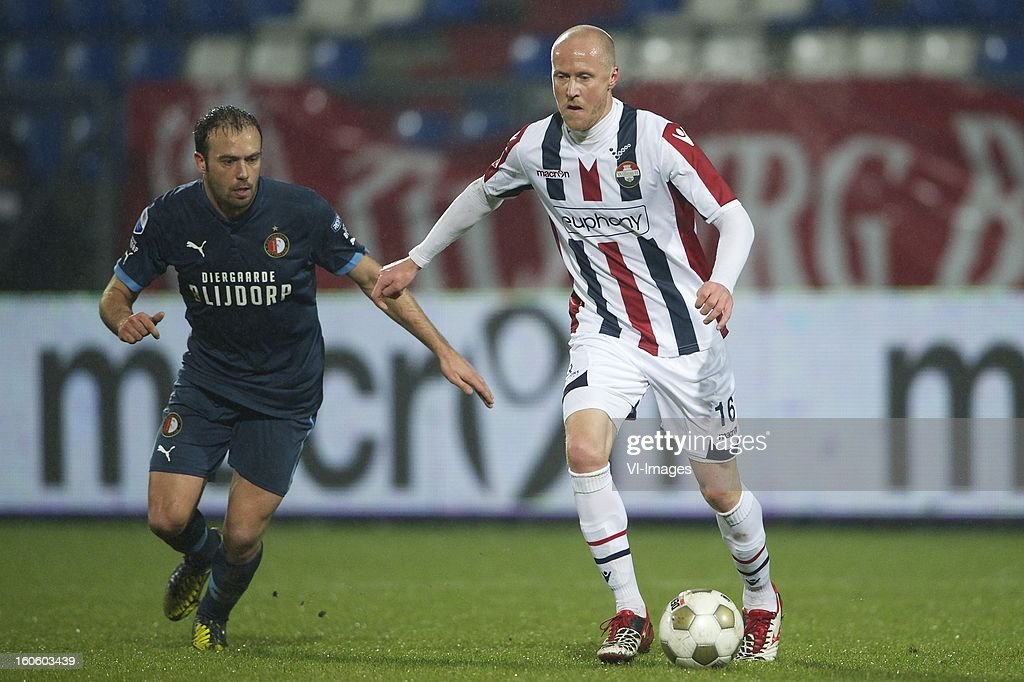 Joris Mathijssen of Feyenoord, Danny Guijt of Willem II during the Dutch Eredivisie match between Willem II and Feyenoord at the Koning Willem II Stadium on february 3, 2013 in Tilburg, The Netherlands