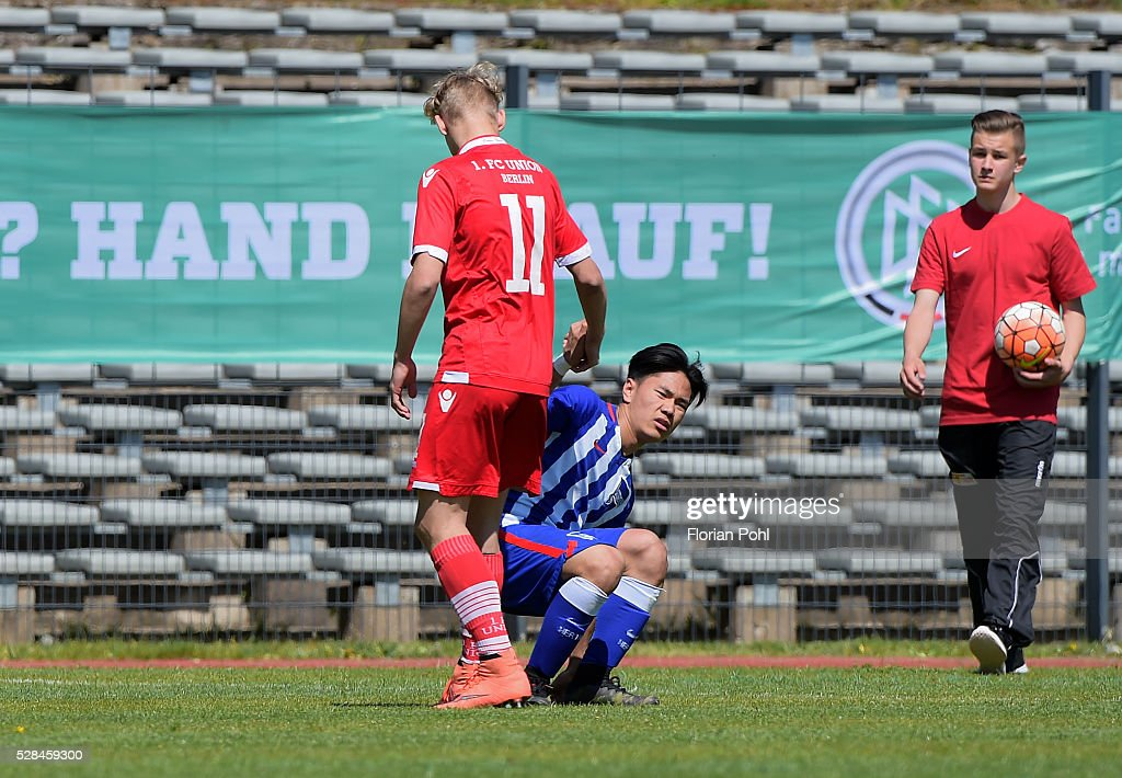 Joris Moeller of Union Berlin and Dennis Chung of Hertha BSC During the C-juniors cup match between 1 FC Union Berlin and Hertha BSC on May 5, 2016 in Berlin, Germany.