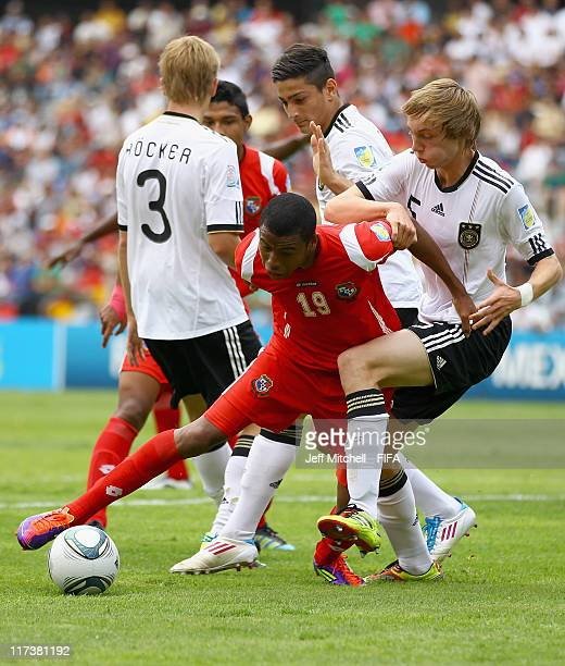 Jorman Aguilar of Panama holds off Nico Perrey of Germany during the Group E FIFA U17 World Cup match between Panama and Germany at the Corregidora...