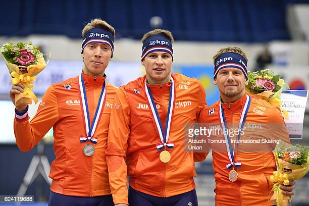 Jorrit Bergsma of Netherlands Sven Kramer of Netherlands and Douwe de Vries of Netherlands pose on the podium after the Men 5000m Division A at M...