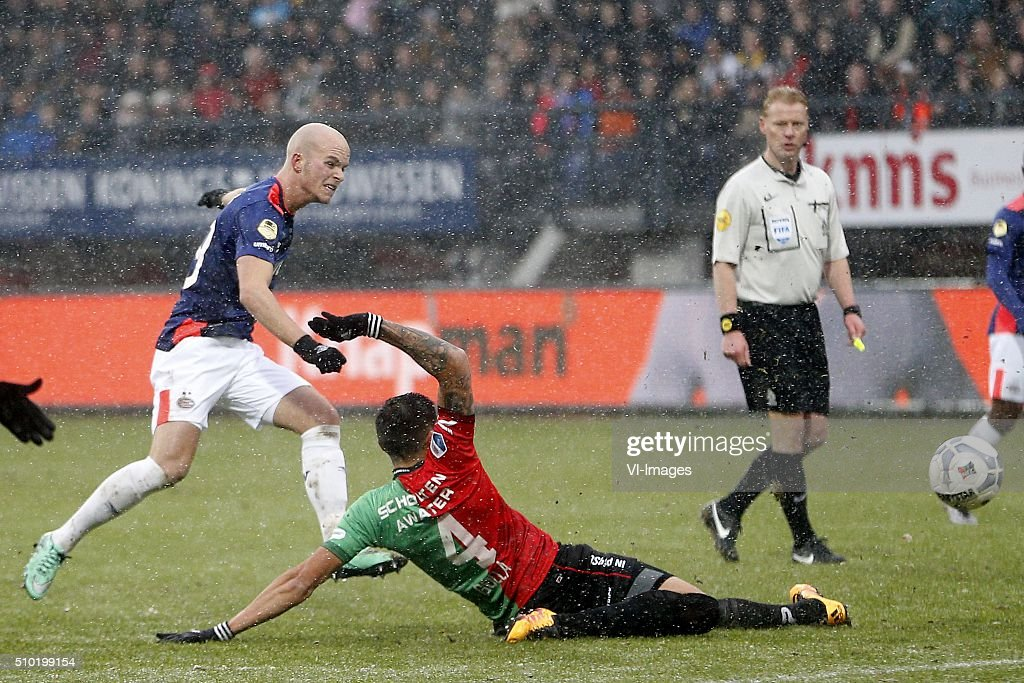 , Jorrit Hendrix of PSV, Golla Wojciech of NEC during the Dutch Eredivisie match between NEC Nijmegen and PSV Eindhoven at the Goffert stadium on February 14, 2016 in Nijmegen, The Netherlands