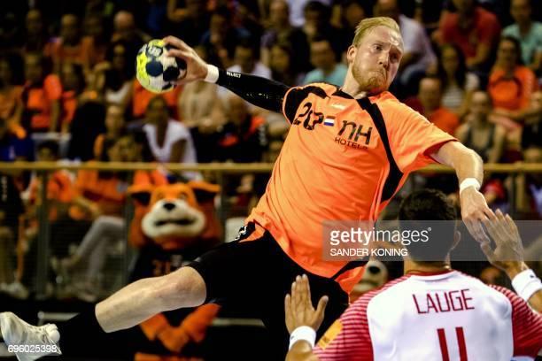 Jort Neuteboom of The Netherlands jumps to shoot on goal during the EC qualification handball match Denmark vs Netherlands in Almere on June 14 2017...