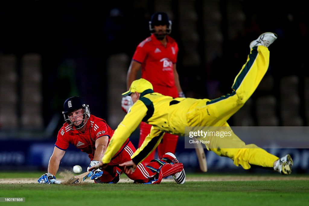 Jos Butler of England dives to make his ground as George Bailey of Australia attempts to run him out during the 5th NatWest Series one day international at the Ageas Bowl on September 16, 2013 in Southampton, England.