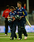 Jos Buttler and James Taylor of England celebrate after winning the 3rd One Day International match between Pakistan and England at Sharjah Cricket...