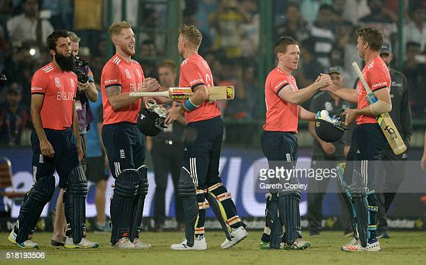 Jos Buttler and Joe Root of England celebrate with Ben Stokes and captain Eoin Morgan after winning the ICC World Twenty20 India 2016 Semi Final...