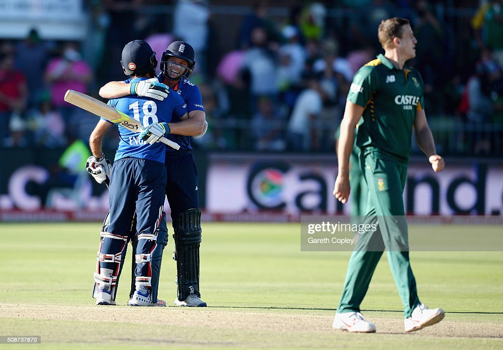 Jos Buttler and Moeen Ali of England celebrate winning the 2nd Momentum ODI between South Africa and England at St George's Park on February 6, 2016 in Port Elizabeth, South Africa.