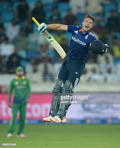 Jos Buttler of England celebrates reaching his century during the 4th One Day International between Pakistan and England at Dubai Cricket Stadium on...