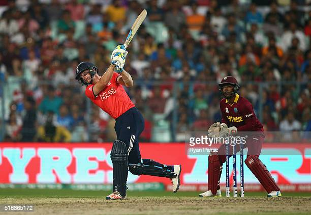 Jos Buttler of England hits a six off Sulieman Benn of the West Indies of the West Indies during the ICC World Twenty20 India 2016 Final match...