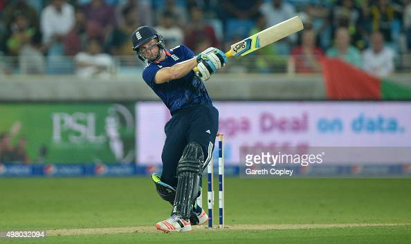 Jos Buttler of England hits out for six runs during the 4th One Day International between Pakistan and England at Dubai Cricket Stadium on November...