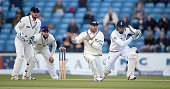 Jos Buttler of England hits past Brendon McCullum of New Zealand during day five of 2nd Investec Test match between England and New Zealand at...