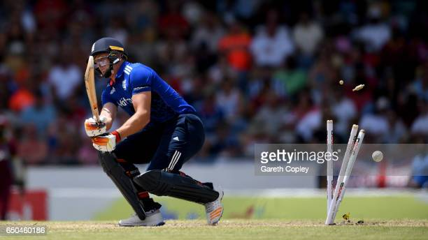 Jos Buttler of England is bowled by Jason Holder of the West Indies during the 3rd One Day International between the West Indies and England at...