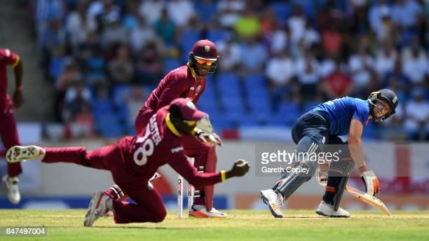 Jos Buttler of England is caught out by Jonathan Carter of the West Indies during the first One Day International between the West Indies and England...