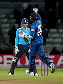 Jos Buttler of England looks on as Sri Lanka's Angelo Matthews celebrates their victory during the 5th ODI Royal London One Day International at...