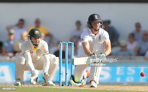 Jos Buttler of England plays a sweep shot during day three of the 5th Investec Ashes Test match between England and Australia at The Kia Oval on...