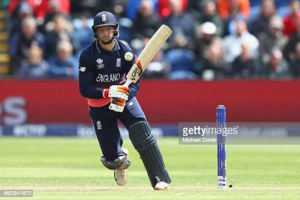 Jos Buttler of England pulls a delivery to the legside during the ICC Champions Trophy match between England and New Zealand at the SWALEC Stadium on...