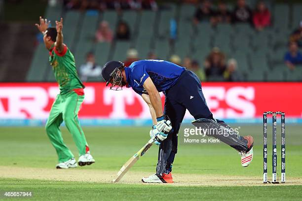 Jos Buttler of England reacts after getting out to Takin Ahmed of Bangladesh during the 2015 ICC Cricket World Cup match between England and...