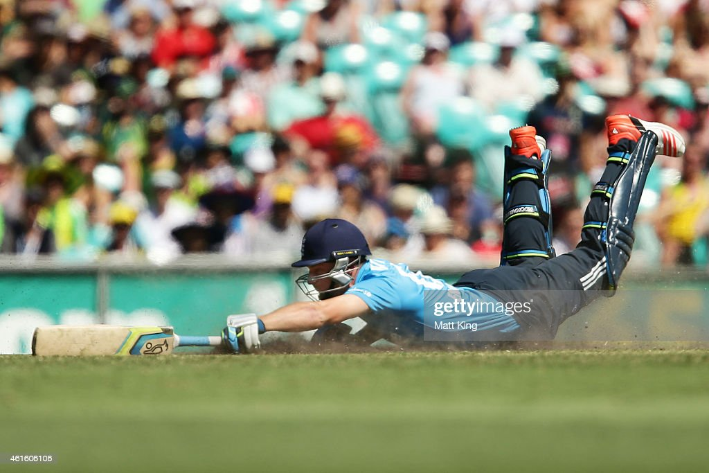 Jos Buttler of England slides in to avoid a runout during the One Day International series match between Australia and England at Sydney Cricket...