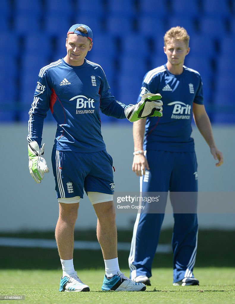 Jos Buttler of England smiles alongside Joe Root during a nets session at Sir Viv Richards Cricket Ground on February 24, 2014 in Antigua, Antigua and Barbuda.