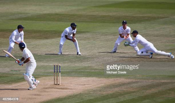 Jos Buttler of England takes a catch off the bowling of James Anderson to dismiss MS Dhoni of India during day five of the 3rd Investec Test match...