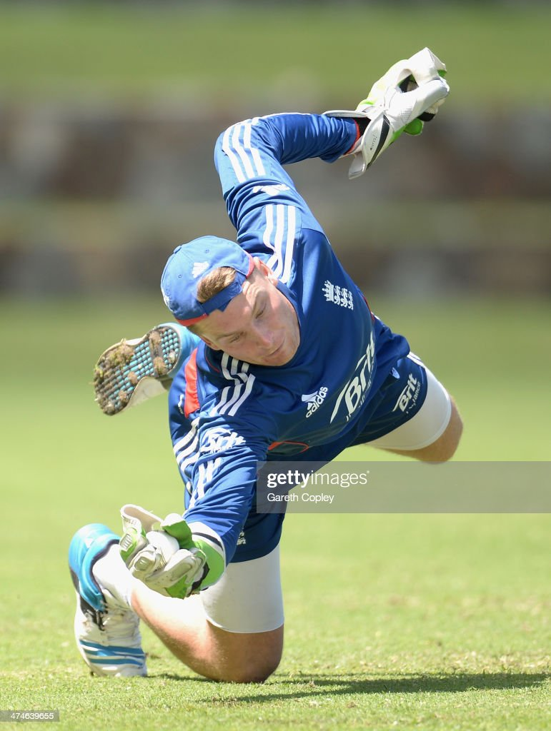 Jos Buttler of England takes part in a wicketkeeping drill during a nets session at Sir Viv Richards Cricket Ground on February 24, 2014 in Antigua, Antigua and Barbuda.