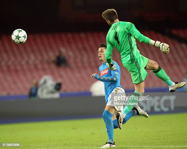 Josè Callejon of Napoli competes for the ball with Fabri of Besiktas during the UEFA Champions League match between SSC Napoli and Besiktas JK at...