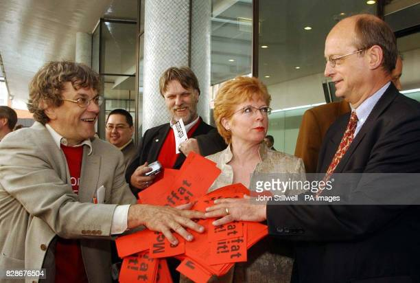 Jos Dugnhoven a Dutch Union leader hands a management employee a pile of forms from the Dutch steel workers Union calling for Sir Brian Moffat the...