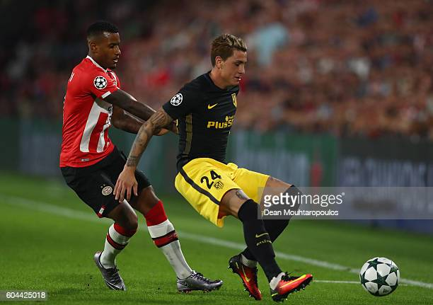 José Gimenez of Atletico Madrid holds of Luciano Narsingh of PSV Eindhoven during the UEFA Champions League Group D match between PSV Eindhoven and...