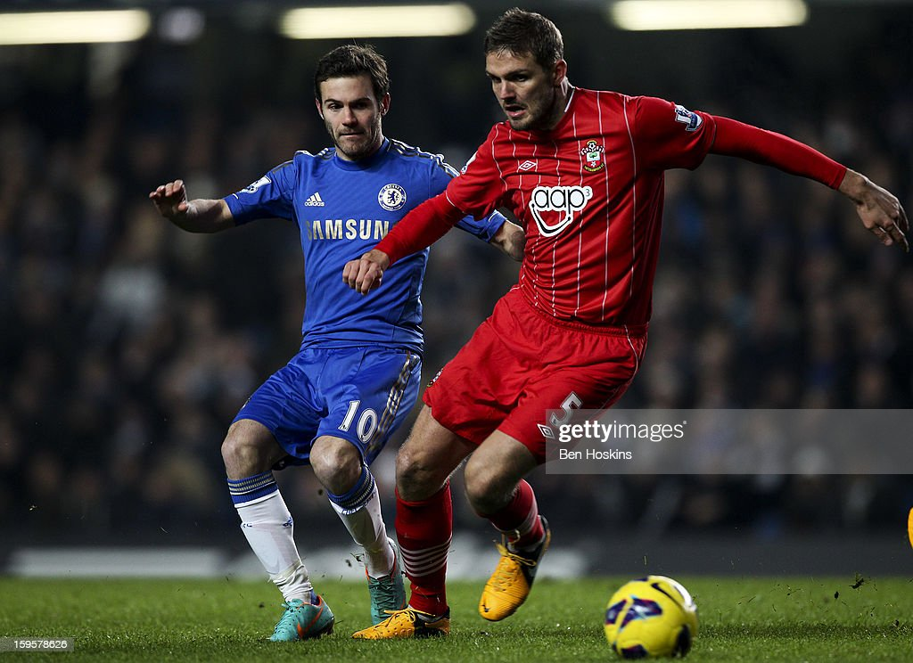 Jos Hooiveld of Southampton is put under pressure by <a gi-track='captionPersonalityLinkClicked' href=/galleries/search?phrase=Juan+Mata&family=editorial&specificpeople=4784696 ng-click='$event.stopPropagation()'>Juan Mata</a> of Chelsea during the Barclays Premier League match between Chelsea and Southampton at Stamford Bridge on January 16, 2013 in London, England.