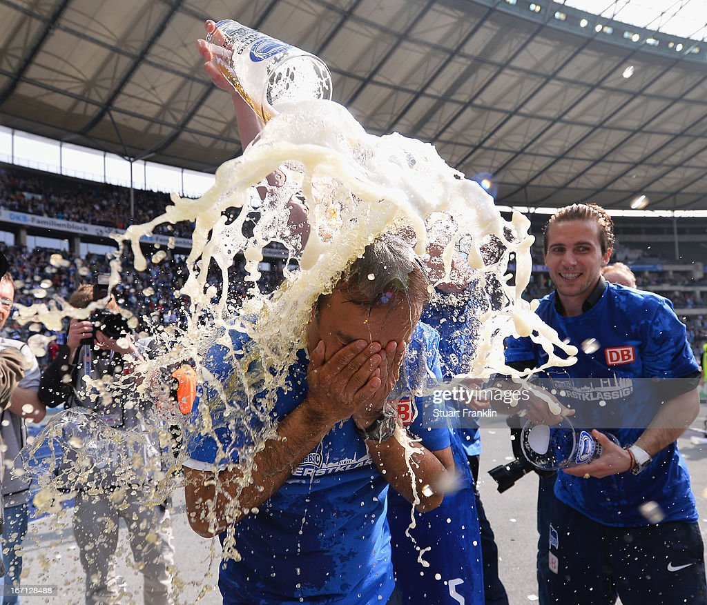 <a gi-track='captionPersonalityLinkClicked' href=/galleries/search?phrase=Jos+Luhukay&family=editorial&specificpeople=673738 ng-click='$event.stopPropagation()'>Jos Luhukay</a>, head coach of Berlin gets showered in beer as his team celebrates promotion to the first leage at the end of the second Bundesliga match between Hertha Berlin SC and SV Sandhausen at Olympiastadion on April 21, 2013 in Berlin, Germany.