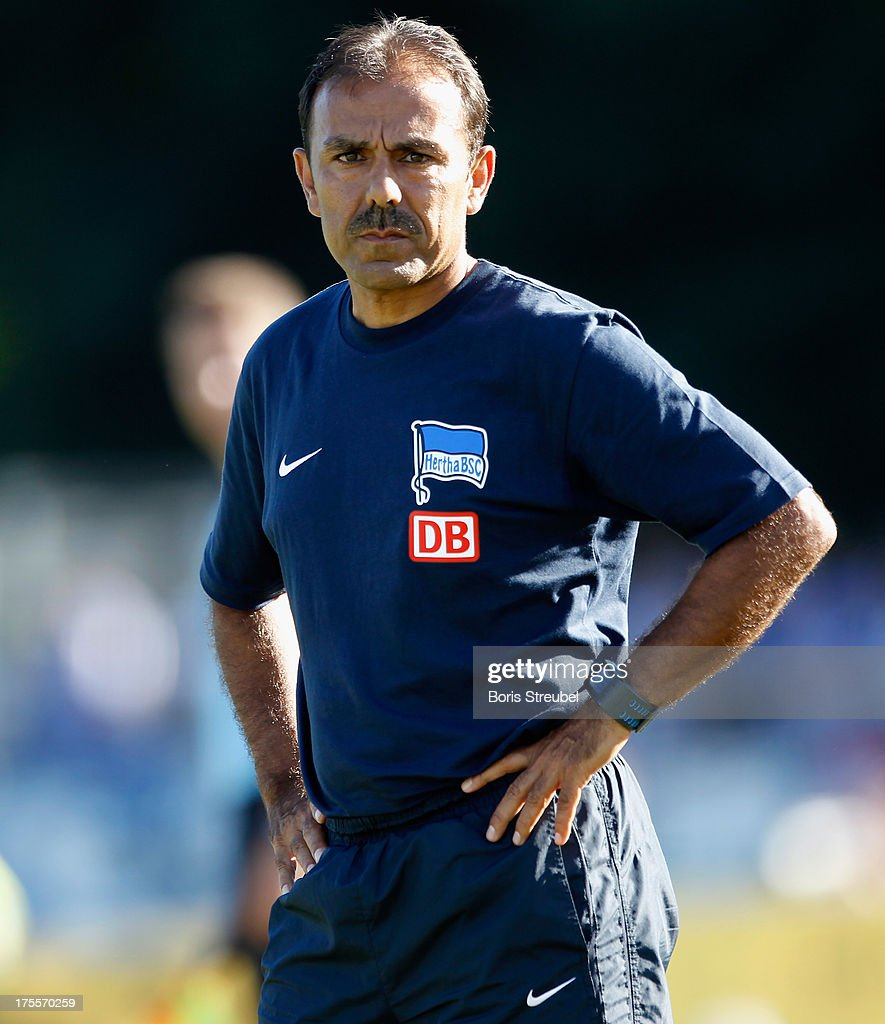 <a gi-track='captionPersonalityLinkClicked' href=/galleries/search?phrase=Jos+Luhukay&family=editorial&specificpeople=673738 ng-click='$event.stopPropagation()'>Jos Luhukay</a>, head coach of Hertha BSC looks on during the DFB Cup first round match between VfR Neumuenster and Hertha BSC Berlin at Gruemmi-Arena on August 4, 2013 in Neumuenster, Germany.