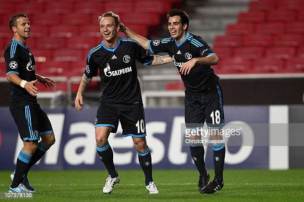 José Manuel Jurado of Schalke celebrates the first goal with Ivan Rakitic of Schalke C and Lukas Schmitz during the UEFA Champions League group B...