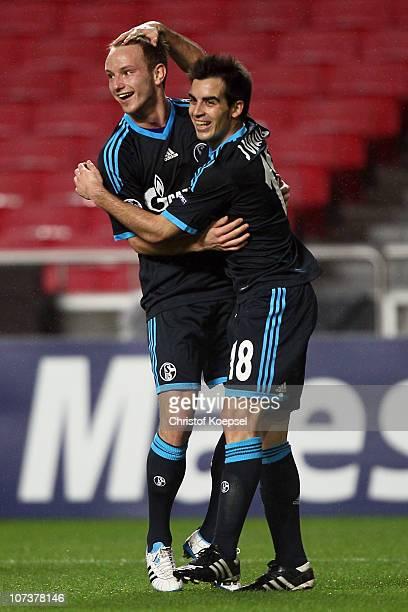 José Manuel Jurado of Schalke celebrates the first goal with Ivan Rakitic of Schalke during the UEFA Champions League group B match between Benfica...