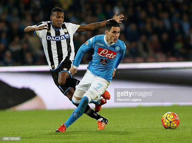 Josè Maria Callejon of Napoli competes for the ball with Edenilson of Udinese during the Serie A match between SSC Napoli and Udinese Calcio at...