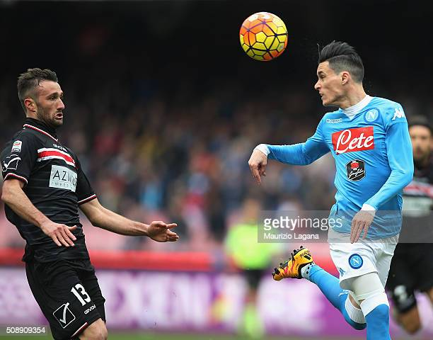 Josè Maria Callejon of Napoli competes for the ball with Fabrizio Poli of Carpi during the Serie A match between SSC Napoli and Carpi FC at Stadio...