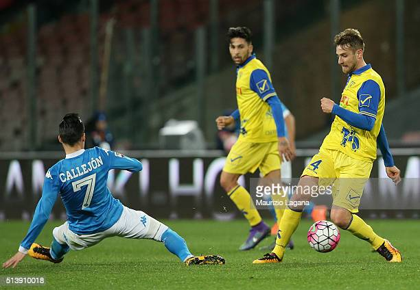 Josè Maria Callejon of Napoli competes for the ball with Nicola Rigoni of Chievo during the Serie A match between SSC Napoli and AC Chievo Verona at...