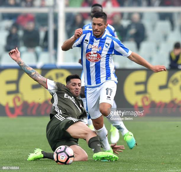 Josè Sosa of AC Milan and Gianluca Caprari of Pescara Calcio in action during the Serie A match between Pescara Calcio and AC Milan at Adriatico...